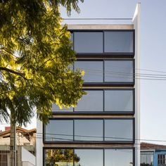 Brazilian apartment block by Arquitetura Nacional features a wall of sliding…