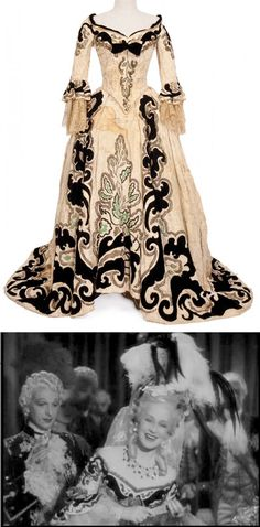 """Norma Shearer """"Marie Antoinette"""" ivory with black velvet two-piece period gown by Adrian from Marie Antoinette. (MGM, 1938) Ivory two-piece period gown, black velvet design, sequins, gold thread and delicate lace at cuffs.  Worn by Norma Shearer as """"Marie Antoinette"""" at the opera in Marie Antoinette. [photo compilation LB]"""