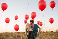 Fun engagement session with red balloons by shiprapanosian.com