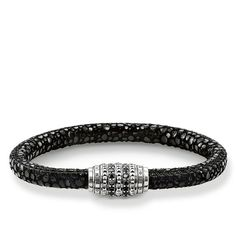 THOMAS SABO Bracelet from the Sterling Silver Collection. This THOMAS SABO bracelet made from filigree twisted stainless steel symbolises the magical attraction of two things that unite to become one. Embellished with black pavé zirconia, the stud design crafted from blackened 925 Sterling silver with integrated steel clasp further develops the characteristic THOMAS SABO looks and is therefore perfect for combining with existing Rebel at heart bracelets. [Artikeltabelle]Category:Bracelet…