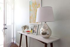Marble console table, mercury lamp, and colorful accessories. Marble Console Table, Living Spaces, Living Room, Closet Bedroom, Furniture Inspiration, Nooks, West Elm, Side Tables, Contents
