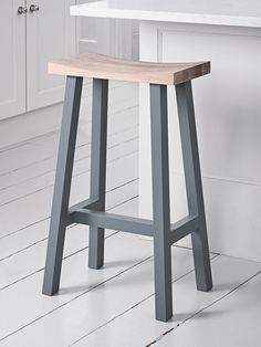 Our Tall Curved Top Stool makes perfect occasional seating for your kitchen or breakfast bar. The beautiful moulded oak seat, has a natural and rustic finish, with complementing charcoal coloured legs. It can be neatly tucked under the work surface or table, for practical and stylish seating.