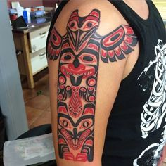 Cool totem tribal tattoo.