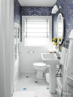 Modern blue and white bathroom with pedestal sink