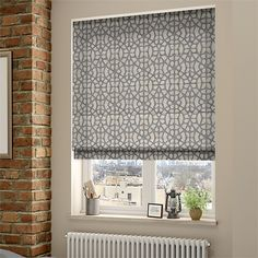 The Swazi African Grey roman blind is all sorts of trendy, with its cool grey colourway, combination of textures and contemporary lattice design.