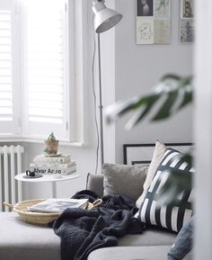 A light, scandi-style living room with painted white floorboards and a grey corner sofa Scandi Living Room, My Living Room, Small Living, Grey Corner Sofa, Cosy Corner, White Floorboards, Light Grey Walls, Scandi Style, Gray Interior