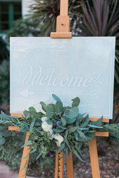 Elegant blue wedding sign with eucalyptus: http://www.stylemepretty.com/2017/04/04/gorgeous-southern-california-rustic-elegant-wedding/ Photography: Jeremy Chou - http://www.jeremychou.com/