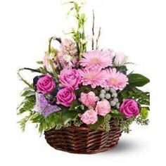 This basket floral arrangement is a popular choice lovely in the pink, lavender and white colour scheme seen here. It includes roses, gerbera daisies, butterflies and much more.