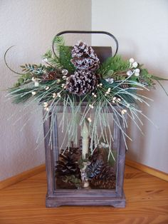 winter lantern with pine cone decoration