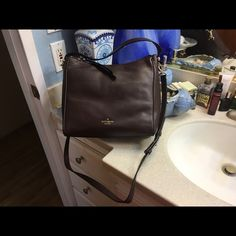 Kate Spade brand new bag brown No tags, was a gift, never used, dust bag inside. Please feel free to make an offer kate spade Bags