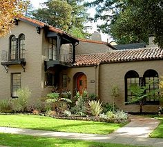 images of painted stucco houses with corbels and trim | Trim: Black / Stucco: Saint Martin Sand #2164-50