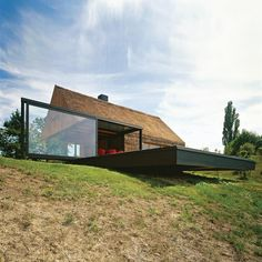 Renovation of a Zagorje cottage by Proarh Studio    The pre-existing house form is kept, while the porch is substituted with a glass cube.