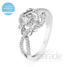 from Parade Design Parade's award-winning Lyria platinum design is the perfect pairing of sleek modernism with vintage romance. Satin brushed flourishes and gracefully intertwining rows of diamonds accentuate a cushion-cut diamond.