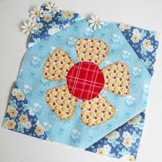 Block 92 - Persistent Daisies. This is my Patchsmith Daisy applique block - popping up in scrap fabrics.