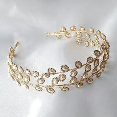 Bridal cream pearl and gold leaf wreath crown tiara headdress. Handmade double tiara band in the Greek laurel wreath style but with a modern twist.  Simple and chic faux glass cream rice pearls are teamed with metallic champagne gold seed beads on a double gilt colour tiara band.  Wired with gilt