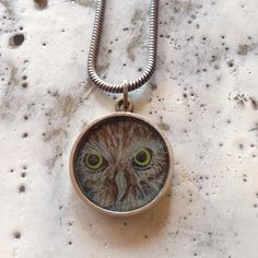 Owl pendant made from one of my drawings. Just listed in my Etsy shop. Use coupon code: INSGRM18 for 18% off. Any questions please email me. Info and links in my bio. #owlnecklace #roneprinzjewelry #jewelryonetsy #jewelryoninstagram #natureinspired #iloveowls #owlportrait #owljewelry #ooak