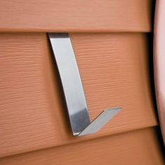 Vinyl Siding Hangers... hmmm.... these could come in handy when hanging holiday decorations...