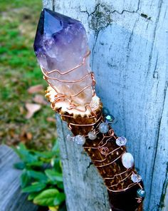 wood, amethyst, moonstone, and labradorite, how pretty.. no particular use, just decorative
