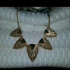Gold Leaf Necklace Gold leaves with rhinestone accents. Sits mid-way on the neck. Sparkly and perfect for fall.   Bundles available! Avon Jewelry Necklaces
