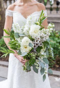 Modern white spring bouquet: http://www.stylemepretty.com/new-york-weddings/new-york-city/2016/04/11/quintessential-manhattan-wedding-for-former-new-yorkers/ | Photography: Ryon:Lockhart - http://www.ryonlockhart.com/