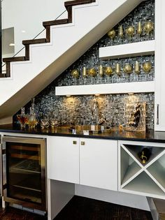 In an excellent use of space, a mosaic tile backsplash becomes the focal point of this home bar, and keeps this area from looking like an afterthought.