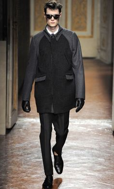 Uniform Dressing; Uniform Dressing Back to the minimalism that we've been expecting for Fall/Winter 2012, comprised almost entirely of polished separates in truly dark hues.  Last Seen At: Valentino's special Pitti Uomo presentation, Fall/Winter 2012