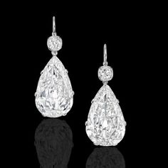 The stunning, bright and lively Victorian old mine pear shaped stones weighing 11.83ct and 10.33ct respectively, each suspended beneath a cushion shaped old mine diamond, all set in beautifully simple contemporary platinum hand crafted mounts with French hook ear wires.