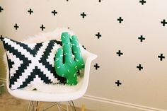 DIY CACTUS PILLOW  Changes I would make: -Add some pom-pom flowers. -Try quilting a layer of batting to the back before sewing the sides together. You should be able to get the stripes of the cactus and also have a less lumps from the stuffing.  -Make sure to make some snips on the curves for a smoother transition.