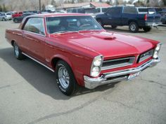 This red 1965 Pontiac GTO is gorgeous. I'll take it as a late holiday gift, if anyone wants to give.