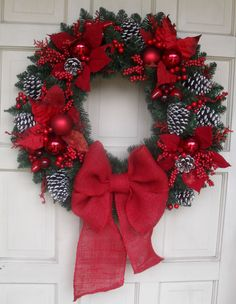"NEW DESIGN 2014 - Beautiful 25"" Red Poinsetta/Pine Cone Traditional Style Christmas Wreath by CustomCraftsbyLynn on Etsy https://www.etsy.com/listing/165994632/new-design-2014-beautiful-25-red"