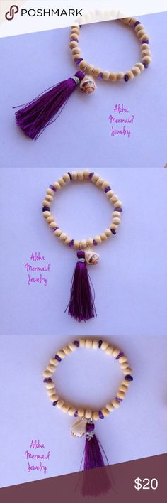 Seashell Tassel Amethyst Bracelet Beach Nautical Stretchy, light-color, wooden beaded boho bracelet has a white and brown Hawaiian spotted stromb shell and a 2-inch purple silk tassel dangling from gold filled jump rings. Between the wooden beads are raw amethyst gemstones. One size fits most. AlohaMermaidJewelry Jewelry Bracelets
