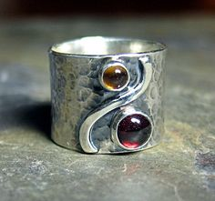 Autumn Afternoon  -  wide band ring of hammered sterling silver set with red garnet and citrine.  Other stones available by request, too!   ...from LavenderCottage on Etsy