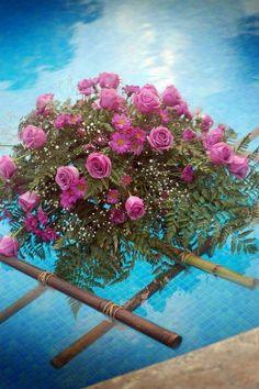 Great flower Idea for wedding by a pool. Jenny G's wedding Dec. 2010