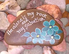 I love rocks! I am always hauling a bucket along when I swim, walk or wade in our many rivers and streams. I love the triangle rocks. This one is hand painted by me, using acrylic paints. There is a clear coat sealer used to protect the design. Teal daisy boquet He alone is my rock and