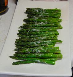 Snack Attack: 35 Genius Mini-Meals With 100 Calories Or Less  12 grilled asparagus spears, tossed with 1 teaspoon olive oil and 1 tablespoon grated Parmesan cheese