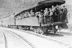 Many early visitors to Glacier arrived by train. Pictured here is a group on an open coach car on the Great Northern Railway.