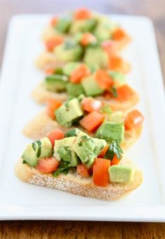 Guacamole Bruschetta on www.twopeasandtheirpod.com An easy appetizer that's perfect for any occasion!
