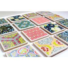 These cute colorful coasters are made with inexpensive tiles from the hardware store and embellished with fun, designer scrapbook paper. We recommend giving guests four coasters each. via The Cottage Mama/