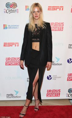 Beauty in black: The Victoria's Secret model flashed her toned tummy in a lace crop top an...