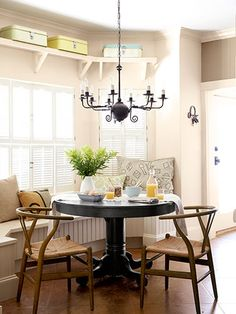Smart: Vintage breadboxes above this dining nook provide sneaky storage for table linens.