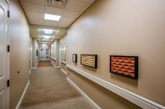 Custom artwork hanging above the handrails is designed to be touched, as a way to provide sensory stimulation to residents as they walk the hallways. Photo: Will van Overbeek Sensory Pathways, Sensory Stimulation, Alzheimer's And Dementia, Elderly Care, Assisted Living, Senior Living, Hallways, Stairs, Van