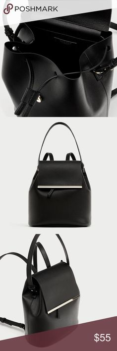 Zara Back Pack with Handle Black BackPack  with metal detail on the flap . Features a top handle adjustable shoulder straps and inside pocket Zara Bags Backpacks