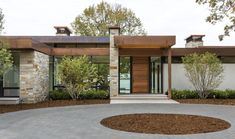 Tagged: Exterior, Flat RoofLine, Metal Roof Material, Wood Siding Material, House, Glass Siding Material, Stucco Siding Material, and Stone Siding Material. Photo 1 of 13945 in Best Photos from Shoreline Residence