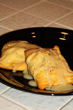 Another twist on Chicken Pillows: crescent rolls, cream cheese, chicken, worcestershire sauce, garlic powder and onion flakes for the inside, and cream of chicken soup, milk, and worcestershire sauce for the sauce topping