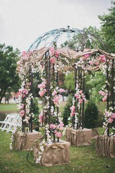 pink flower and burlap gazebo ceremony decoration - image by studio castillero