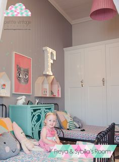 Little Girl's bedroom by Petite Vintage Interiors, painted wicker chest is adorable, marquee letters for each sister is also adorbs!