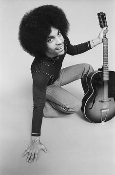 Young Prince picture with guitar.