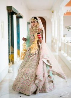 A pastel lehenga is a perfect attire for a day wedding. Moreover, it is quite pairable with some light jewellery designs that will not make you look overly dressed. Indian Bride Dresses, Indian Bridal Outfits, Muslim Wedding Dresses, Indian Bridal Lehenga, Bridal Dresses, Pakistani Bridal, Bridesmaid Dresses, Wedding Lehnga, Wedding Mandap