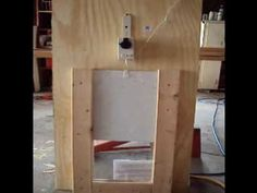 Automatic Chicken coop door to make from an electric drape opener and timer switch....