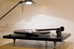 """The trendy Rega Planar 2, the most-imitated audiophile turntable. Why? Poor isolation, and high flutter-and-wow (worse than some 1970s record changers) gives this deck a thick, veiled sound. No wonder aftermarket modifications abound. Tip: don't bother """"upgrading"""" a Rega, just buy a good turntable to begin with."""
